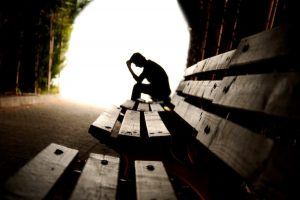 depression therapy slumped over bench